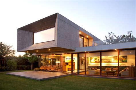 u shaped house with glass lower floor and concrete