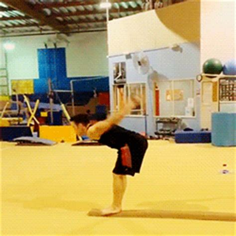 gymnastics back handspring layout stepout because real men do beam