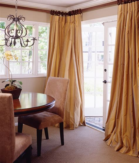 should curtains go to the floor living room drapes in silk that puddle gracefully