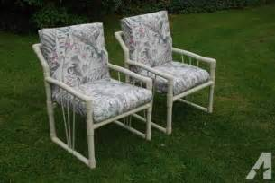 two pvc furniture patio chairs with cushions for sale in