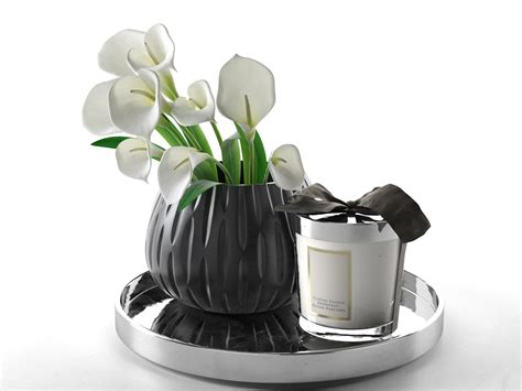 calla in vase and home candle