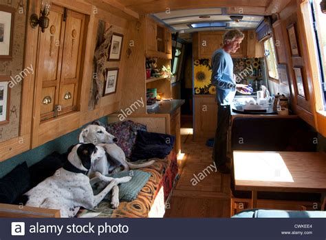 living on a canal boat two dogs living on canal boat with owner stock photo