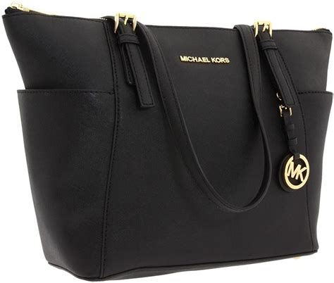 Tas Michael Kors Original Michael Kors Jetset Travel Bag Gold Pale bolsos michael kors tote