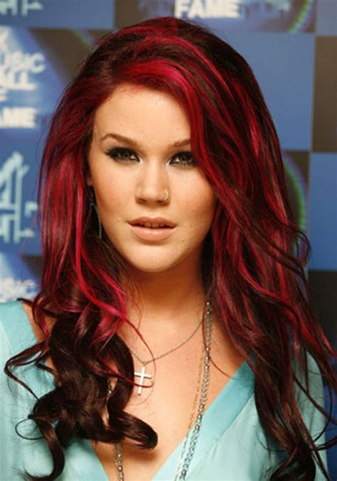 black hair to raspberry hair chose to work some thin raspberry streaks into her dark