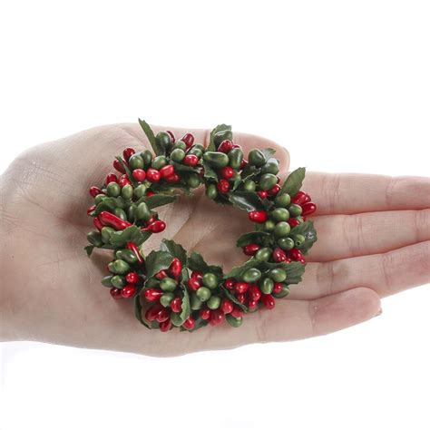 red and green pip berry candle ring candles and