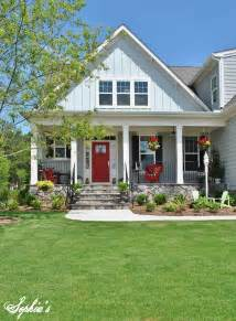 s farmhouse style front porch with pops of