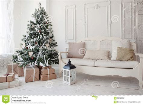Living Room Presents Tree With Presents Underneath In Living Room