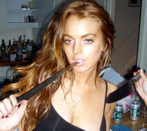 Lindsay Lohan Plays With Knives oh lindsay will you win popbytes