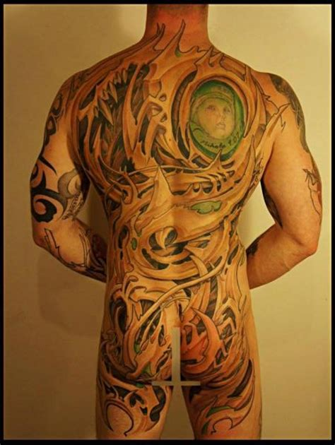 biomechanical back abstract tattoo by white rabbit tattoo