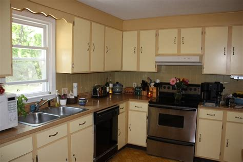 Can You Paint Kitchen Cabinets Two Colors In A Small Kitchen The Decorologist Kitchen Paint Two Tone Kitchen Cabinets With Range Hoods And Laminate Wood Flooring For Small