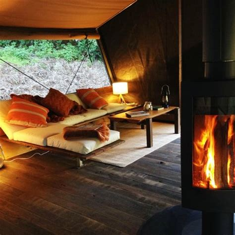tent with fireplace inside a nightfall wilderness c luxury tent fireplace