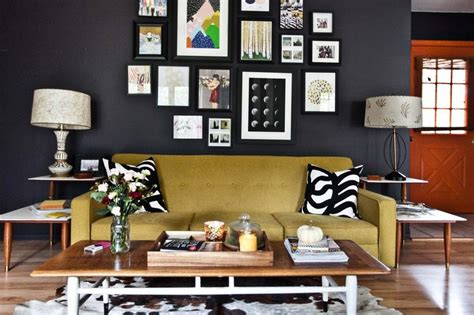 black painted living room a gallery grouping of pops against black walls decoist