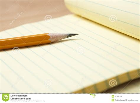 yellow notepad  pencil stock  image