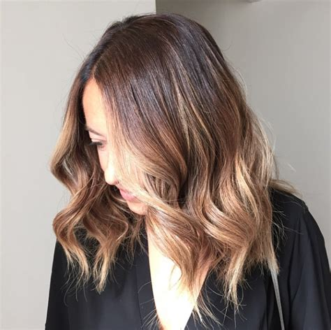 7 easy ways to style midlength hair lob heavy bangs and bangs what is the new hairstyle called the lob what is the new