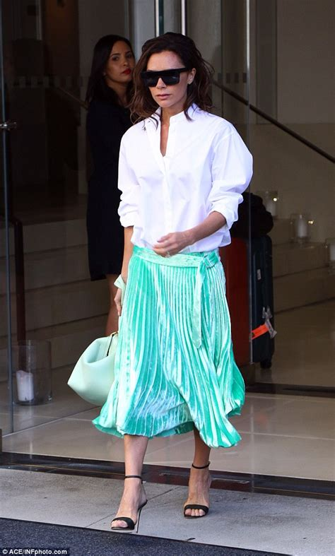 Victory Skirt beckham steps out of new york hotel in a