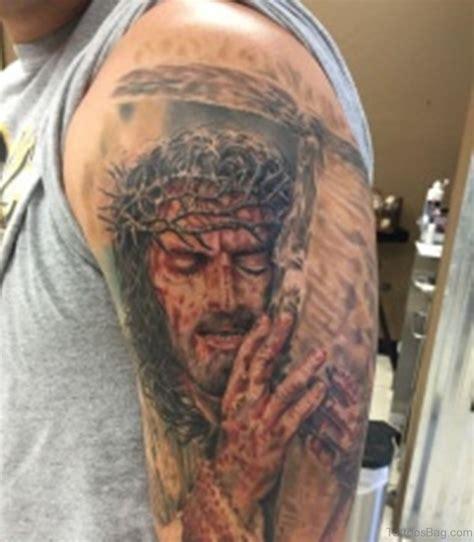 tattoo of jesus holding a man 61 classic jesus tattoos on shoulder