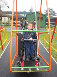 swing for child with disabilities inclusive play independent living