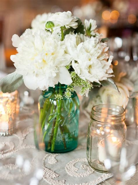 jar centerpieces wedding centerpiece with white flowers in jarwedwebtalks wedwebtalks