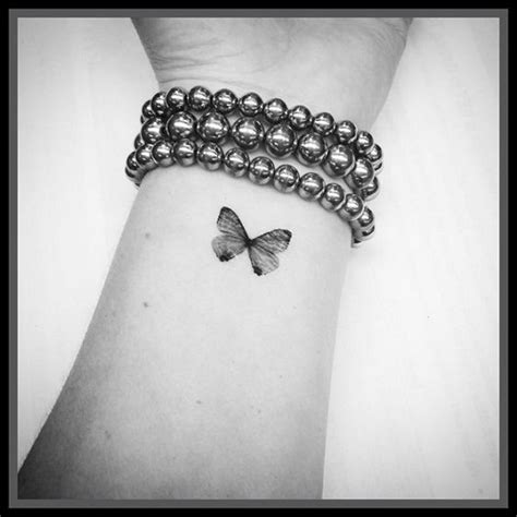small black butterfly tattoo 169 most attractive butterfly tattoos august 2018 part 7