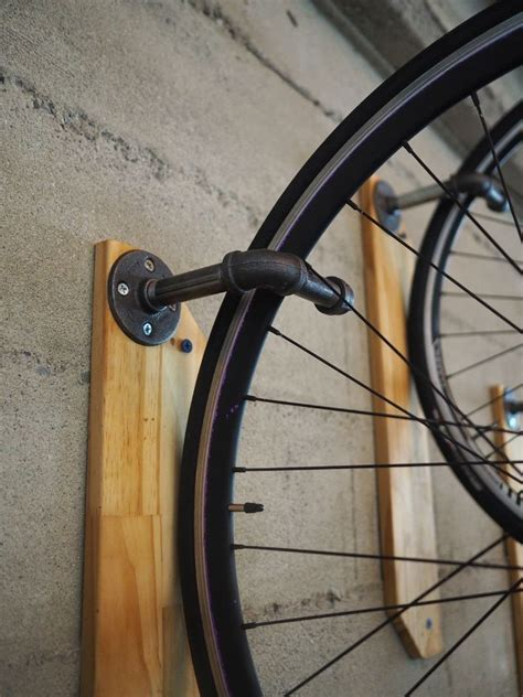 bike wall hanger three ingenious bike hangers with designs