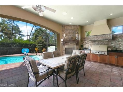 outdoor lanai outdoor dining on the lanai with gas fireplace and decor