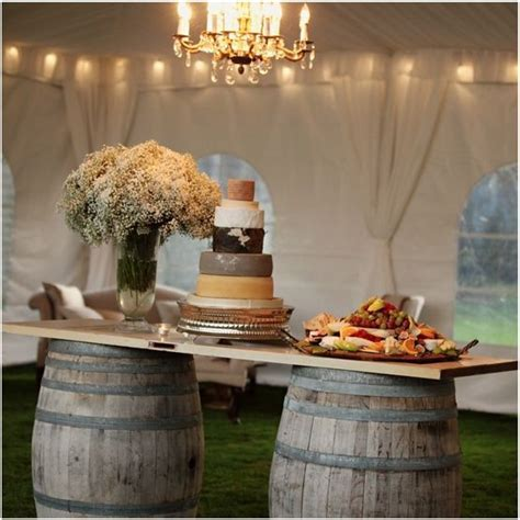 cheese display table made of wine barrels and wooden door