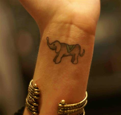 tiny elephant tattoo tiny elephant on wrist