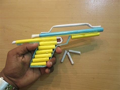 How To Make A Pistol Out Of Paper - how to make a paper gun that shoots paper bullets easy