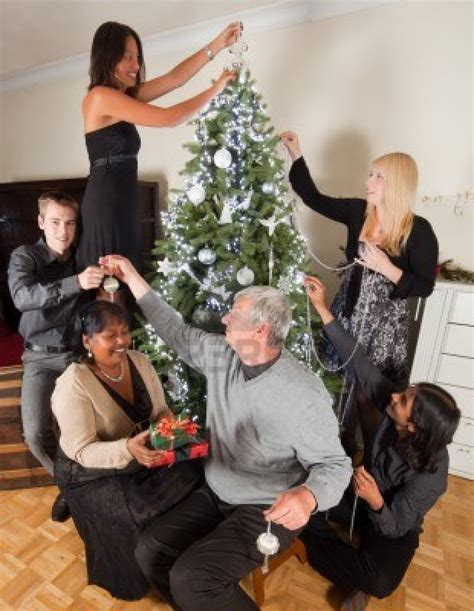 10761444 happy family decorating together the christmas
