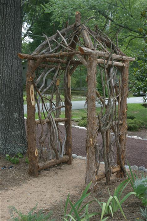 Garden Arbor Made From Branches Cedar Arbor Liberated Gardener