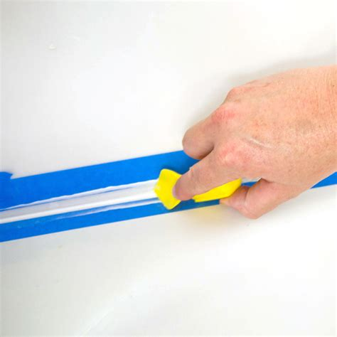 how to put caulking around a bathtub how to caulk around a bathtub popsugar smart living