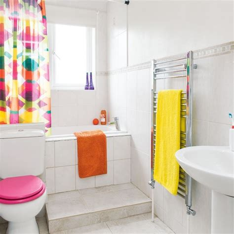 red and yellow bathroom white bathroom with pink yellow and orange accessories