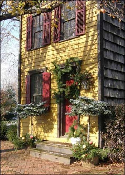 yellow house red door yellow house with red door shutters doors pinterest