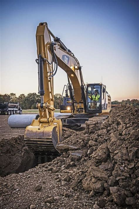caterpillar unveils  hybrid excavator story id  construction equipment guide