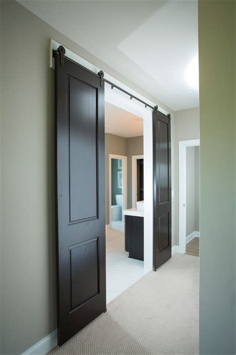 bathroom with 2 entrances barn doors entrance to master bathroom by schumacher