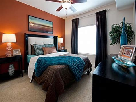 teal brown bedroom love this room the orange accent wall with teal and