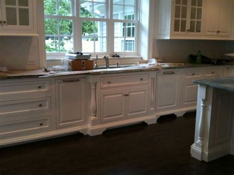 kitchen cabinets with feet cabinet feet forward set sink split post mouldings