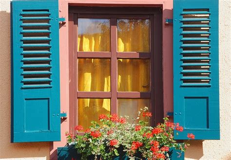 blue shutters window: blue shutters with yellow curtains and window box