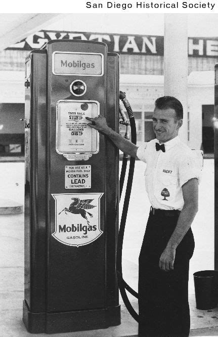 a gas station attendant standing next to a gas