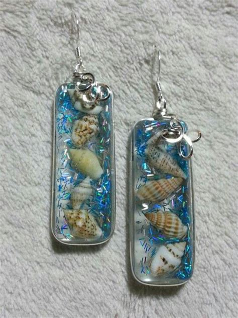 Handmade Resin Jewellery - handmade resin shell and glitter earings wraped with