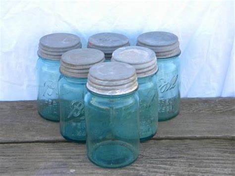 vintage metal canisters vintage glass containers with lids vintage old vintage aqua blue green glass fruit jars lot antique