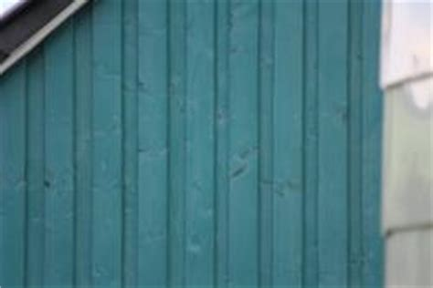 farbe für dachziegel gruene holzfassade bauunternehmen