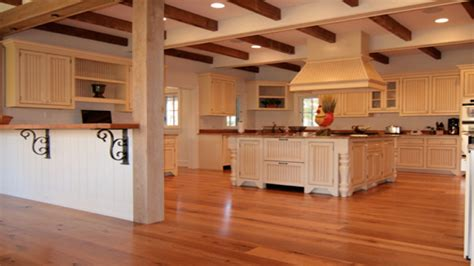 kitchen with light oak cabinets cork kitchen floors oak kitchen cabinets with wood floors