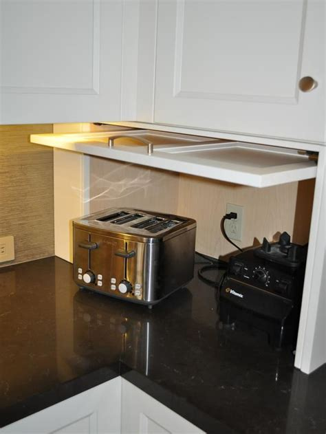 kitchen cabinet garage hide your kitchen appliances with a garage style cabinet