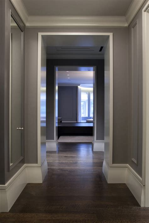 baseboards hall contemporary with gray crown molding