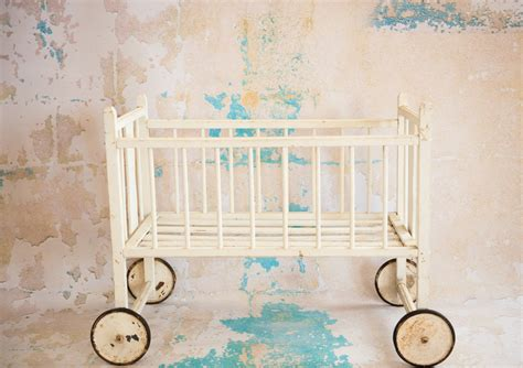 vintage antique doll crib on wheels by