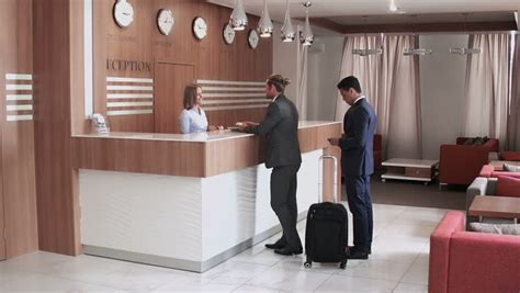 What Is Another Term Used For Desk Checking by Hotel Receptionist Stock Footage