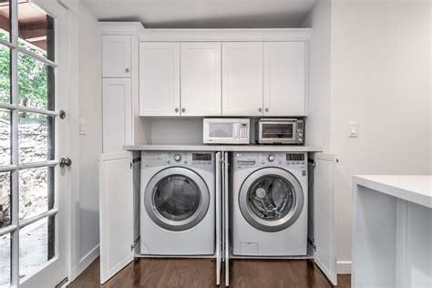 doors to hide washer and dryer barn door cabinets to hide washer dryer in the kitchen