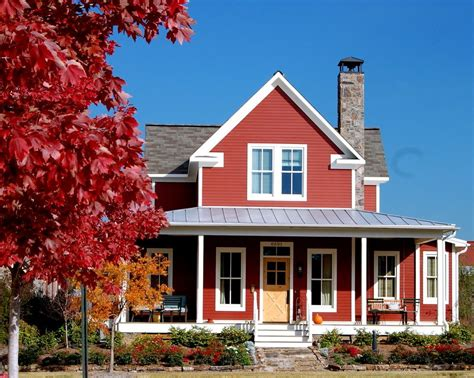 red house with a porch photograph by les palenik the village at gracy farms with farmhouse exterior and