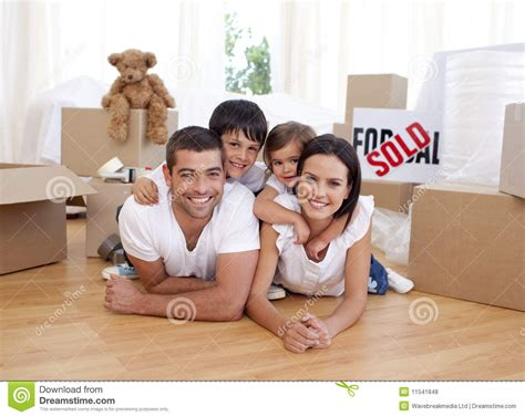 buying house from family happy family after buying new house royalty free stock